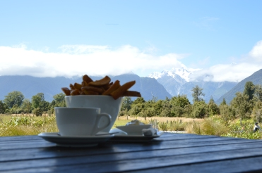 Enjoying the view from the cafe with Flat White and Chips (fries)